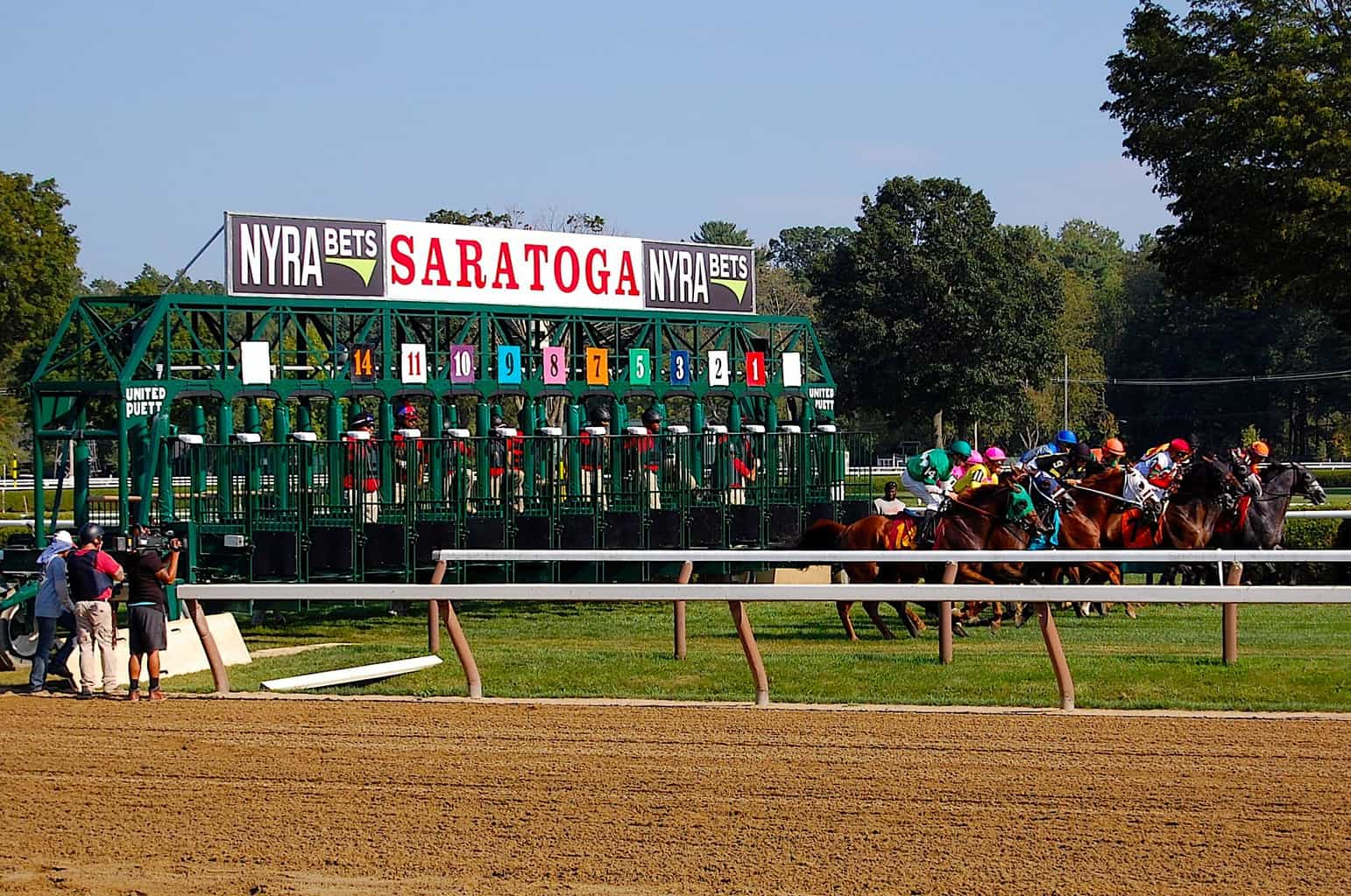 The horses coming out of the starting gate at Saratoga Racetrack.