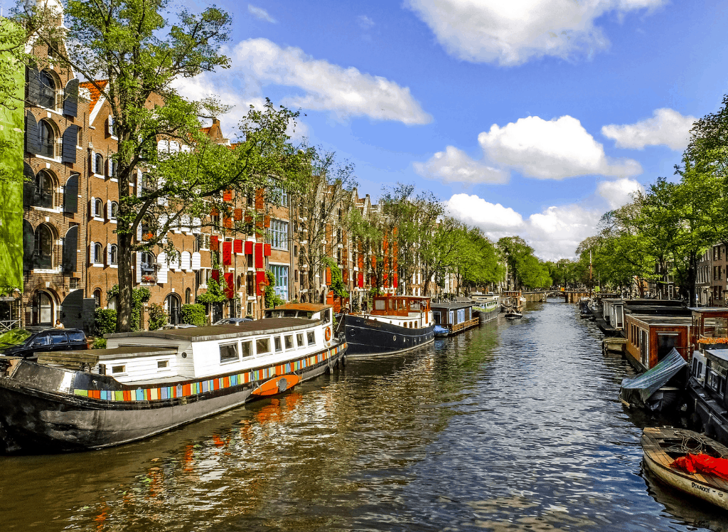 Houseboats lined up along a canal in Amsterdam.
