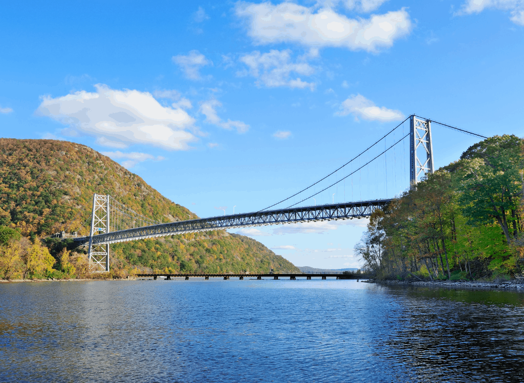 A panoramic view of the Bear Mountain Bridge, the Hudson River, and Anthony's Nose, one of the best hikes in upstate New York.