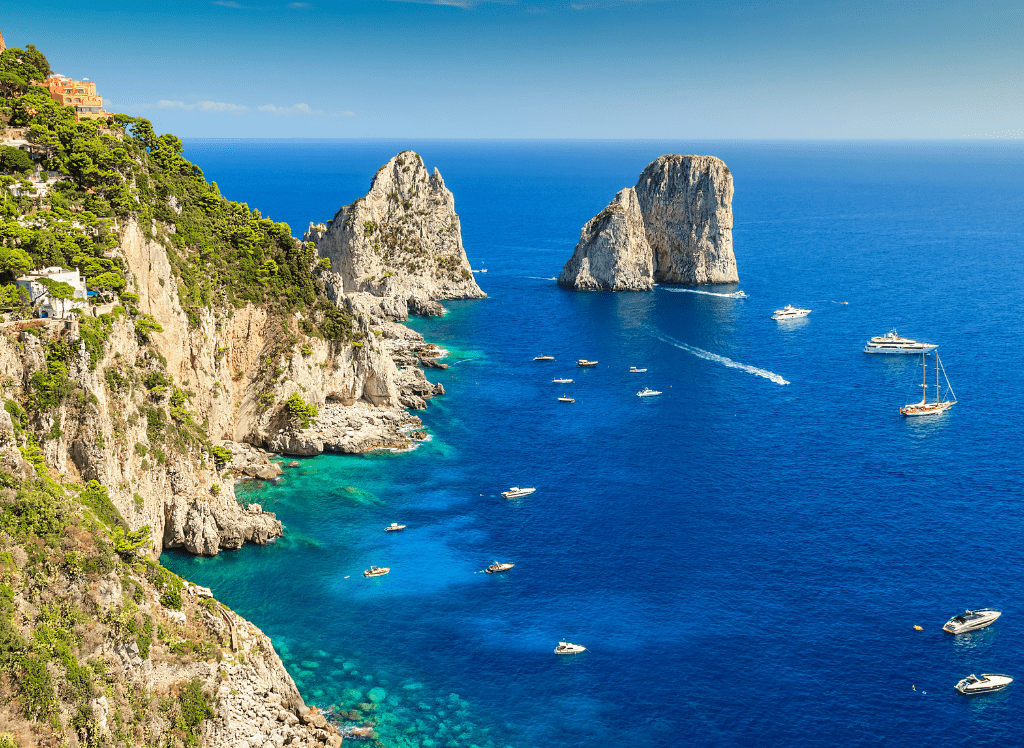 A view of the beautiful coast and vibrant blue waters od Capri, Italy.