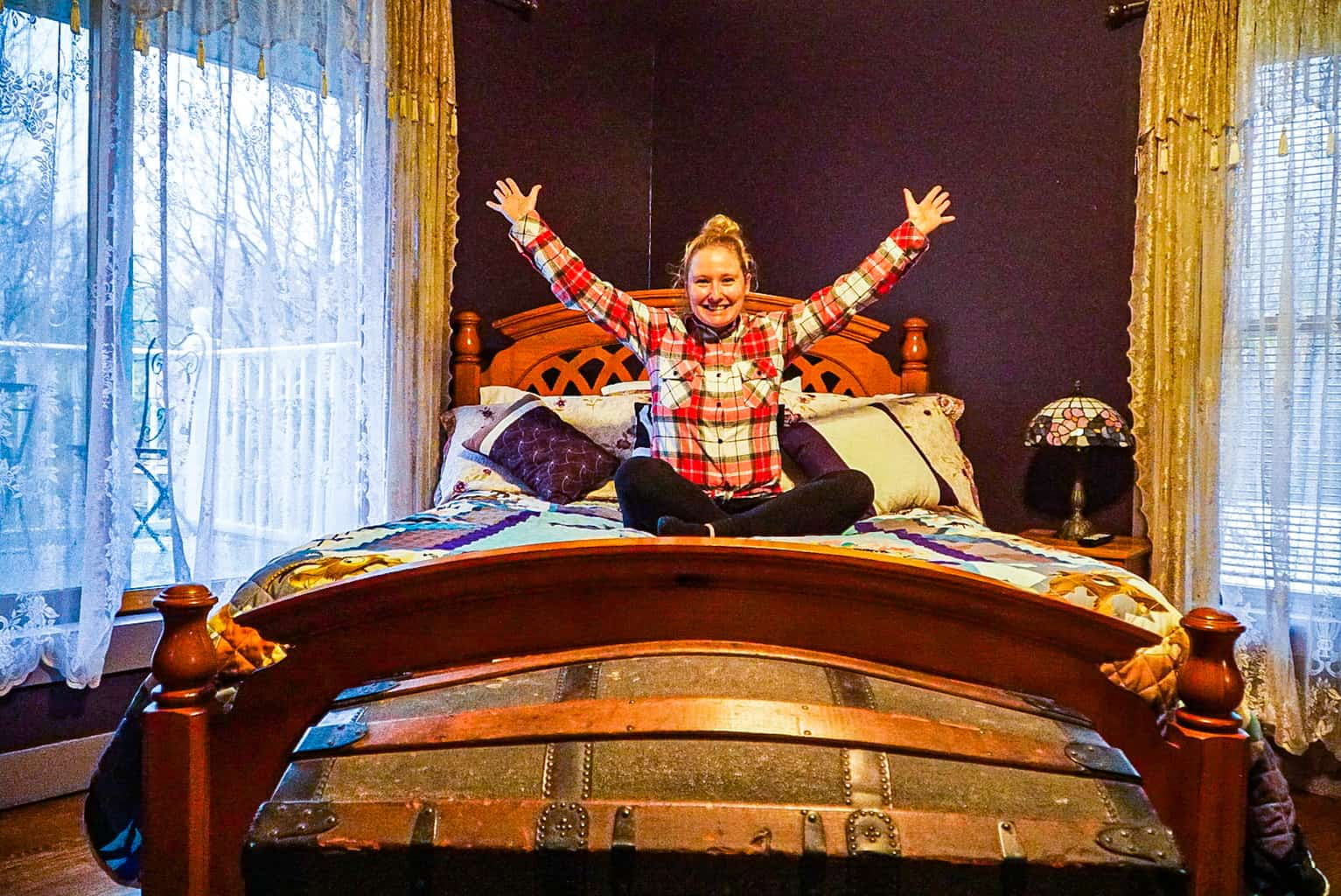 Me on the bed in the Fainting Room at the Fainting Goat Island Inn.