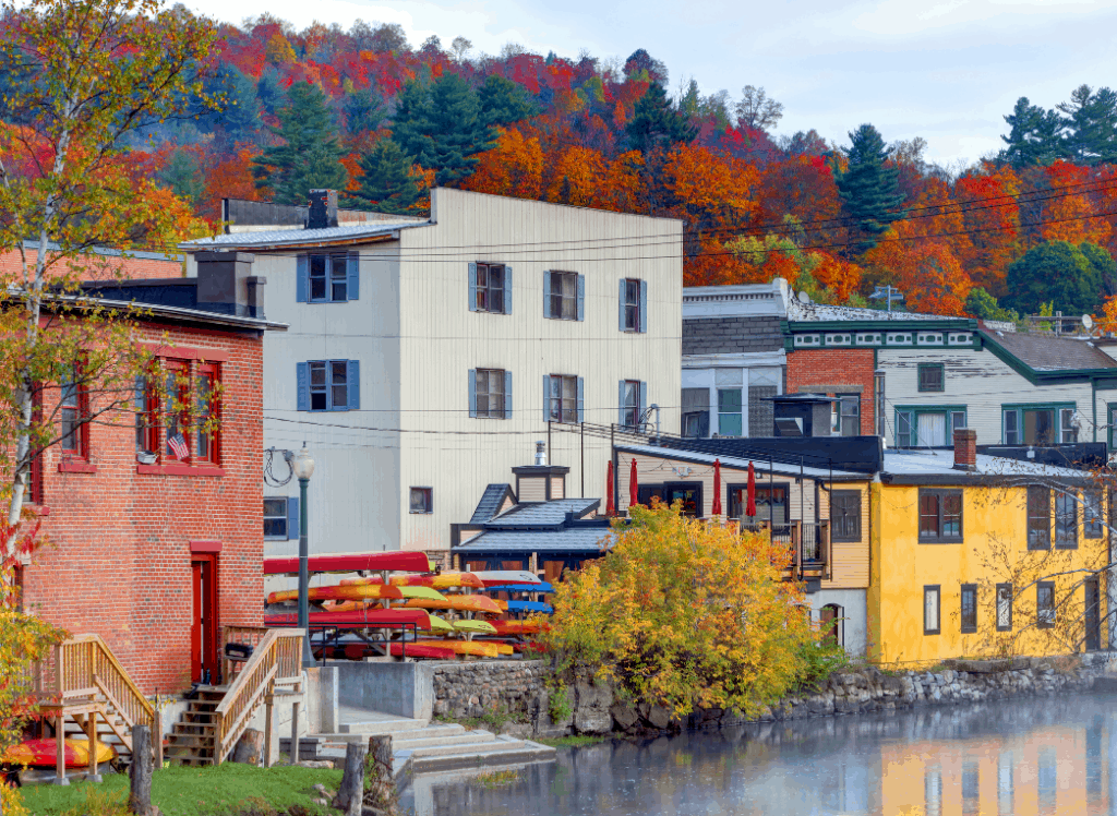 Vibrant buildings along a river in downtown Saranac Lake.