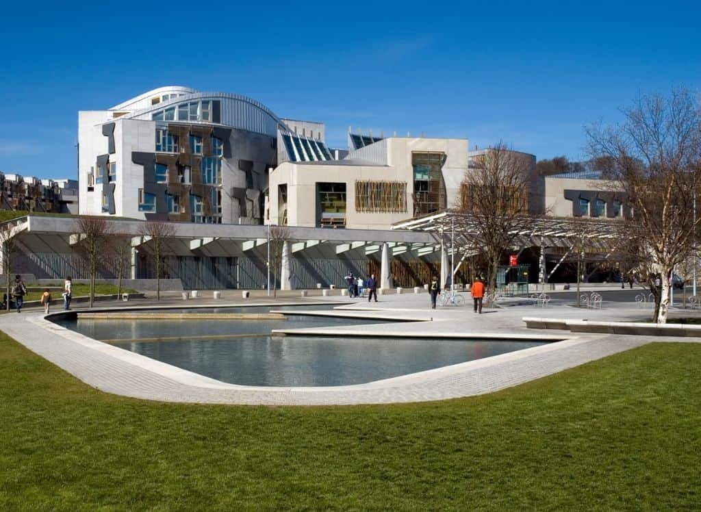 The ultra-modern exterior of the Scottish Parliament Building in Edinburgh, Scotland.