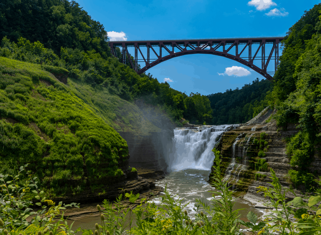 The stunning, Upper Falls of Letchworth State Park with the railway bridge behind it.