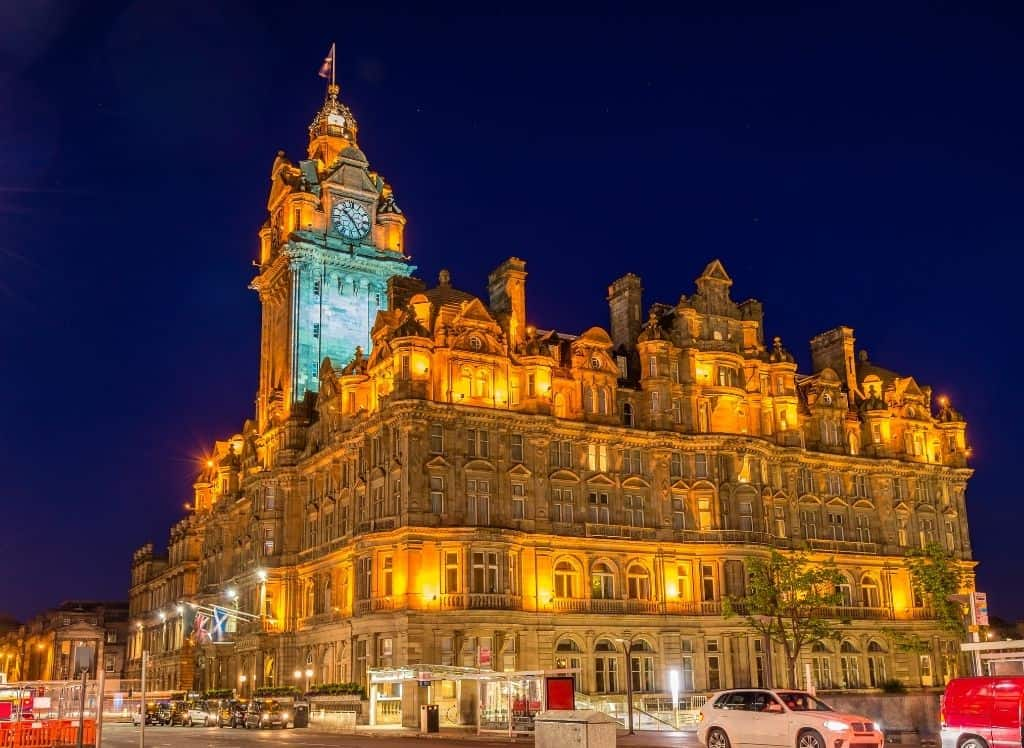 The beautiful Balmoral Hotel all lit up in the evening in Edinburgh.