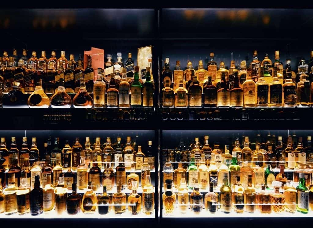 Scottish Whiskey lining bar shelves in Edinburgh.