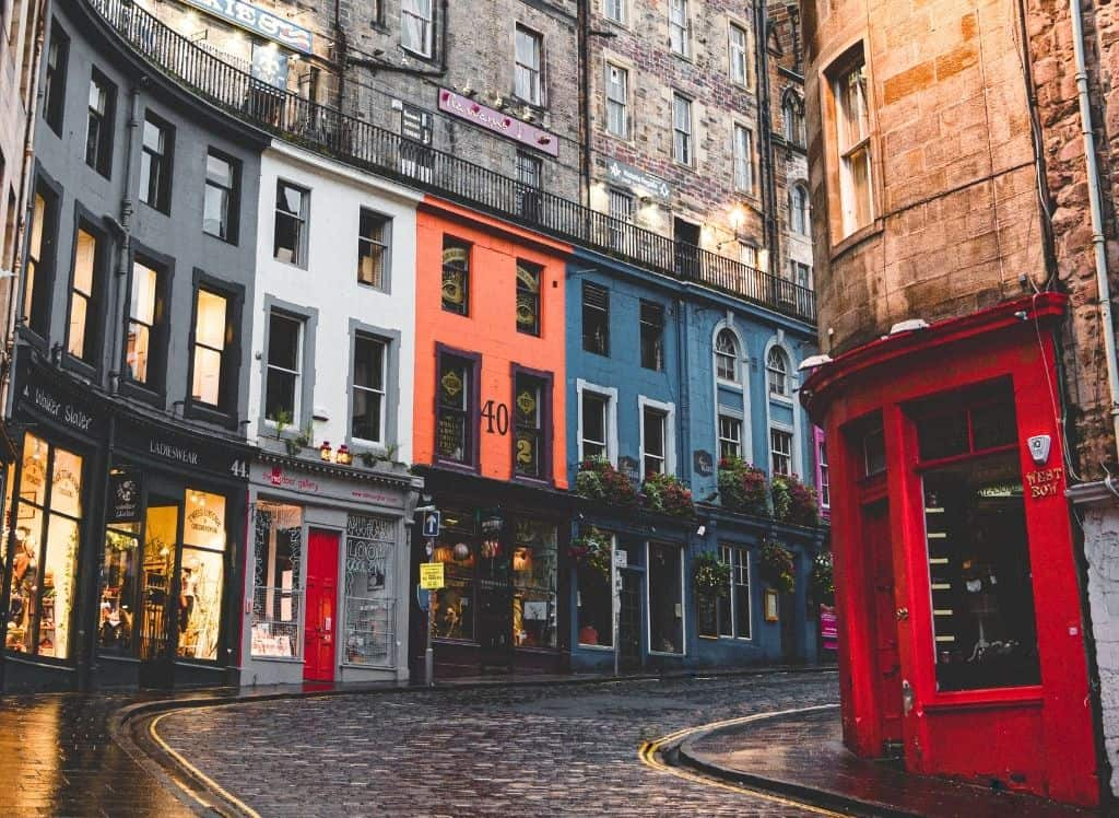 The array of colorful shops that line the streets of Victoria Street in Edinburgh.
