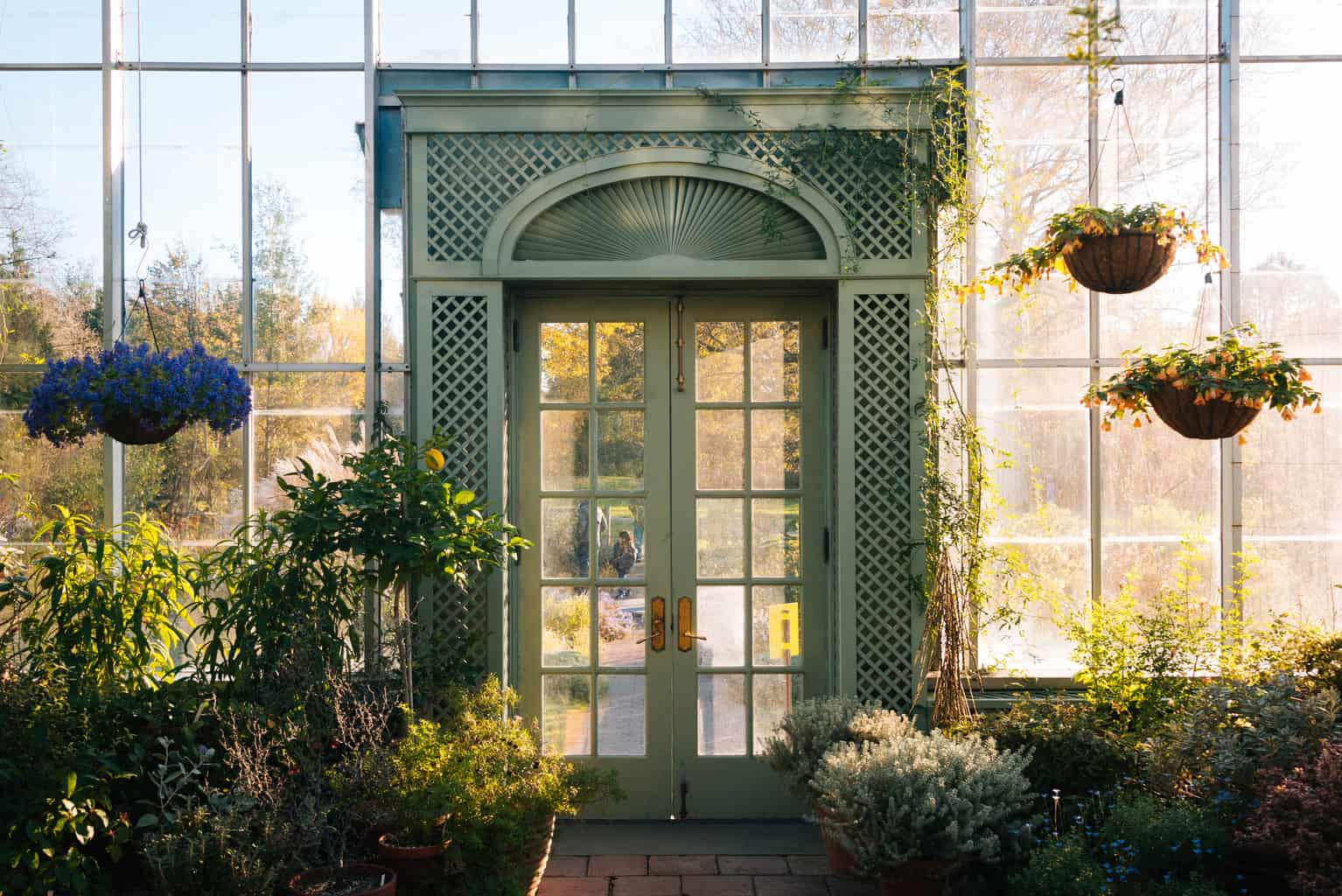 The green, greenhouse door at Wave Hill Public Gardens in The Bronx.