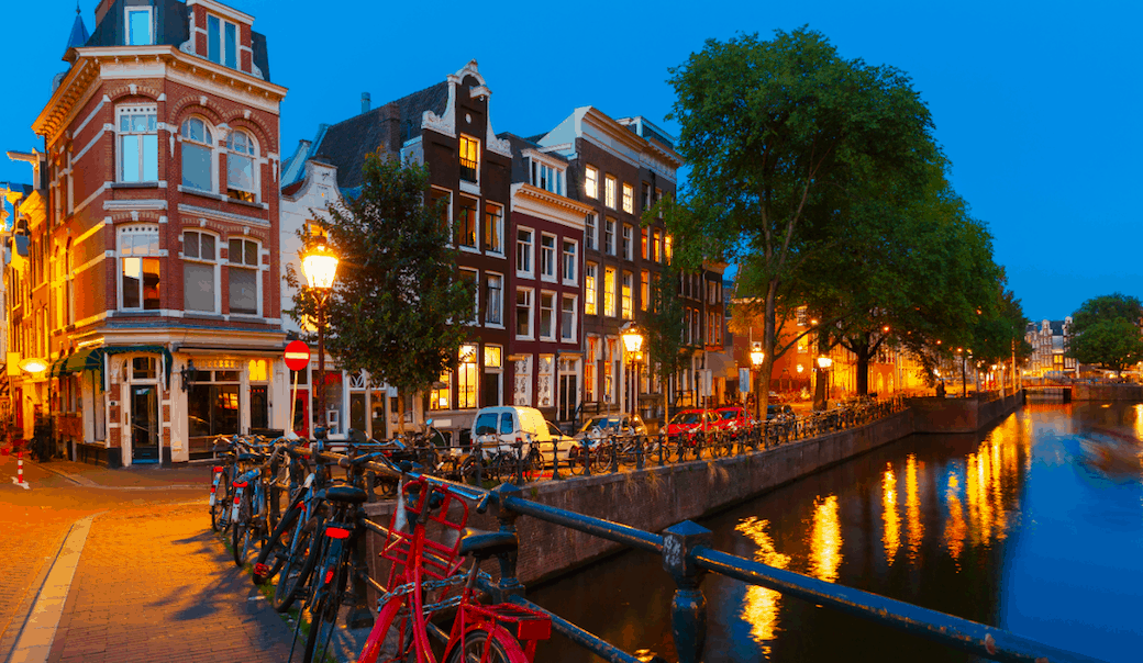 The canal-side street of Herengracht in Amsterdam, one of the many beautiful Amsterdam streets.