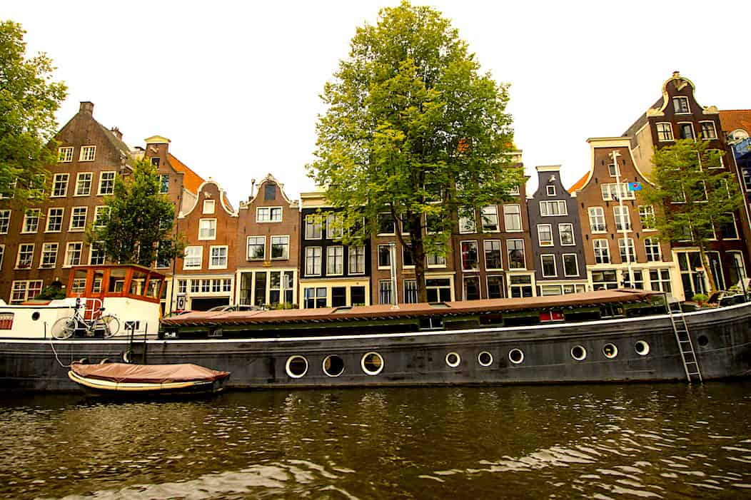 Houses line Oude Waal which sits along a canal in Amsterdam.
