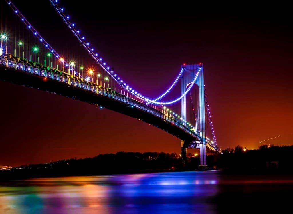 New York's Verrazano Bridge all lit up in the evening.
