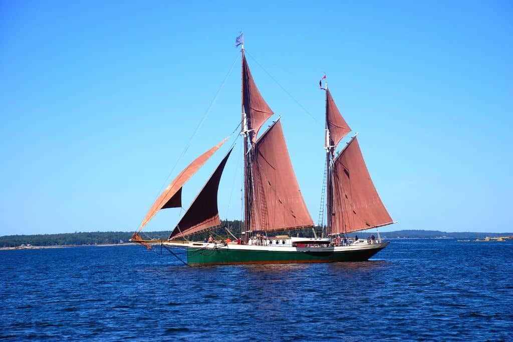 A Maine windjammer with red sails.