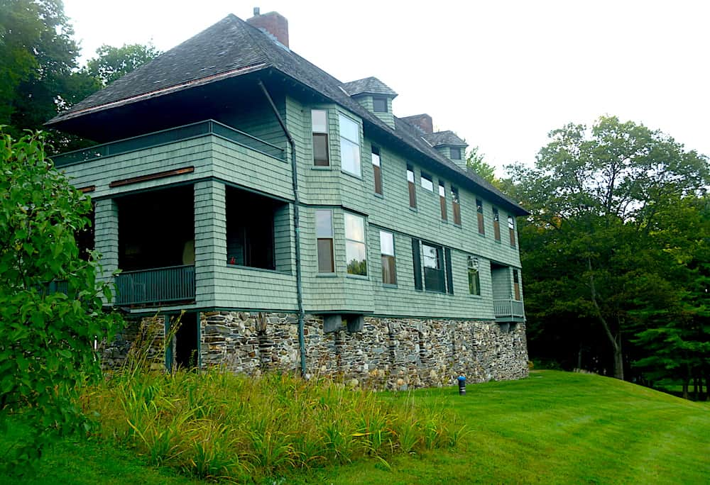 The beautiful green exterior of the Naulakha house in Vermont.