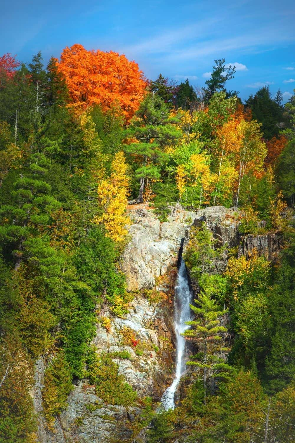 Roaring Brook Falls surrounded by fall foliage.