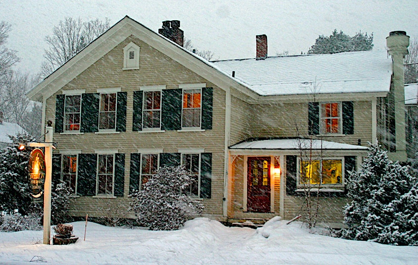 The inn at Weston covered in snow.