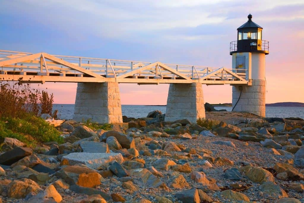 A view of the Marshall Point Lighthouse at dusk in Maine.