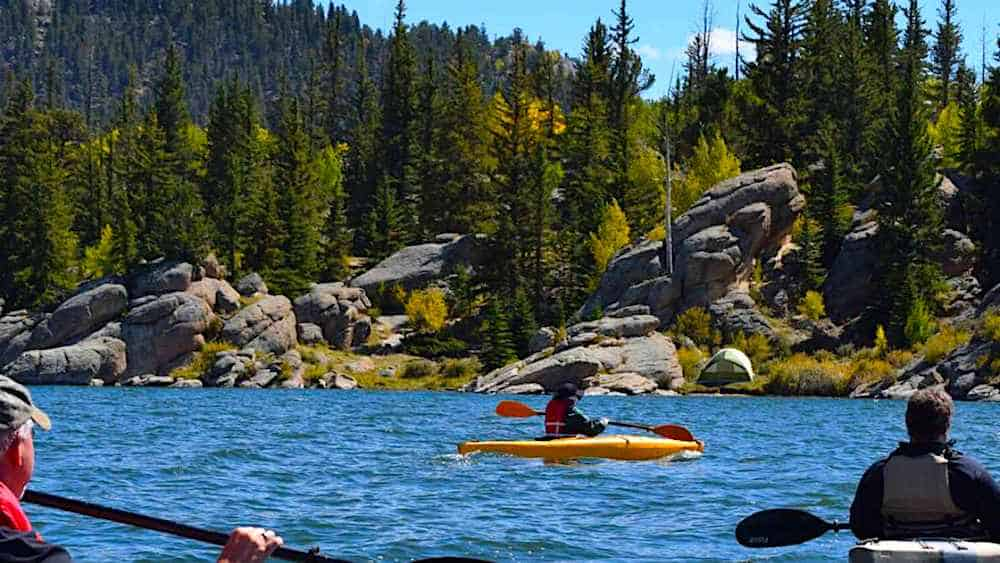Kayakers on the lake in Deer Isle Maine.