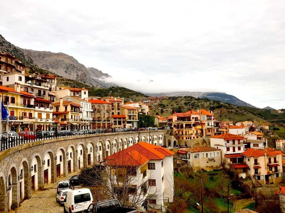 red-tile roof homes sit along the hillsides of Arachova, Greece.