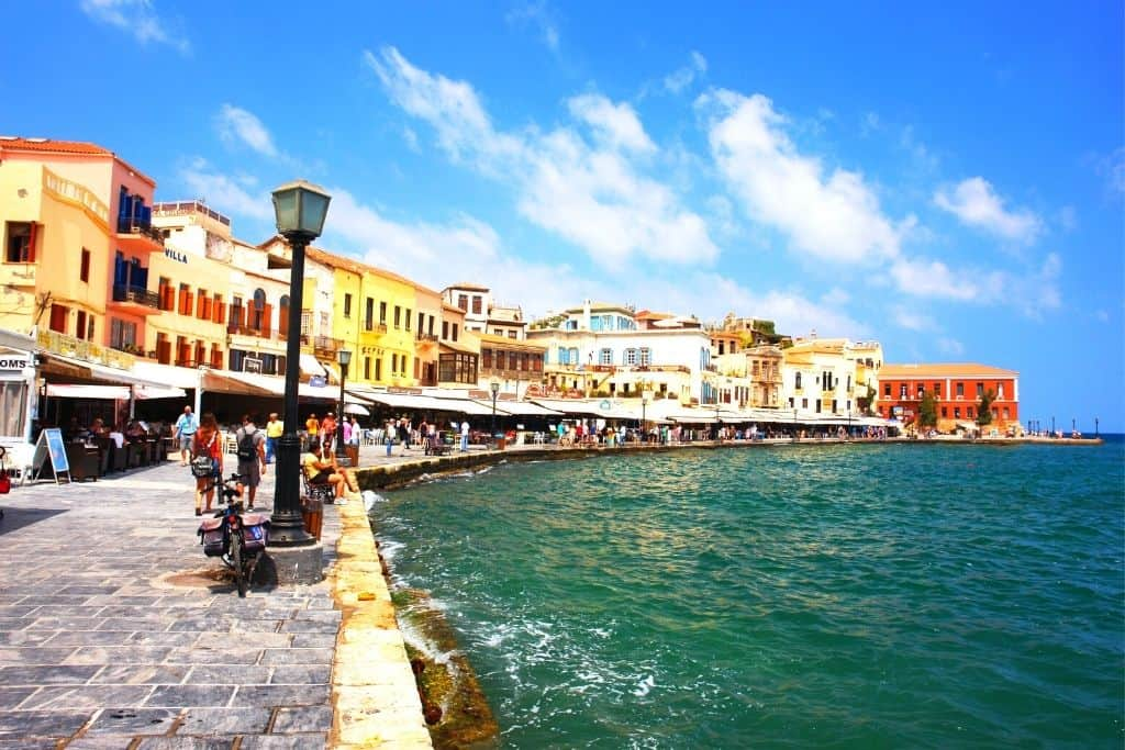 Vibrant, Venetian-style buildings along the harbor in Chania, Crete.