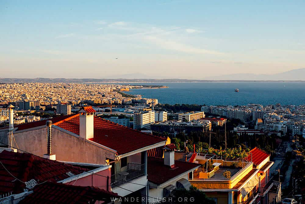 The sun setting over the harbor in Thessaloniki, Greece.