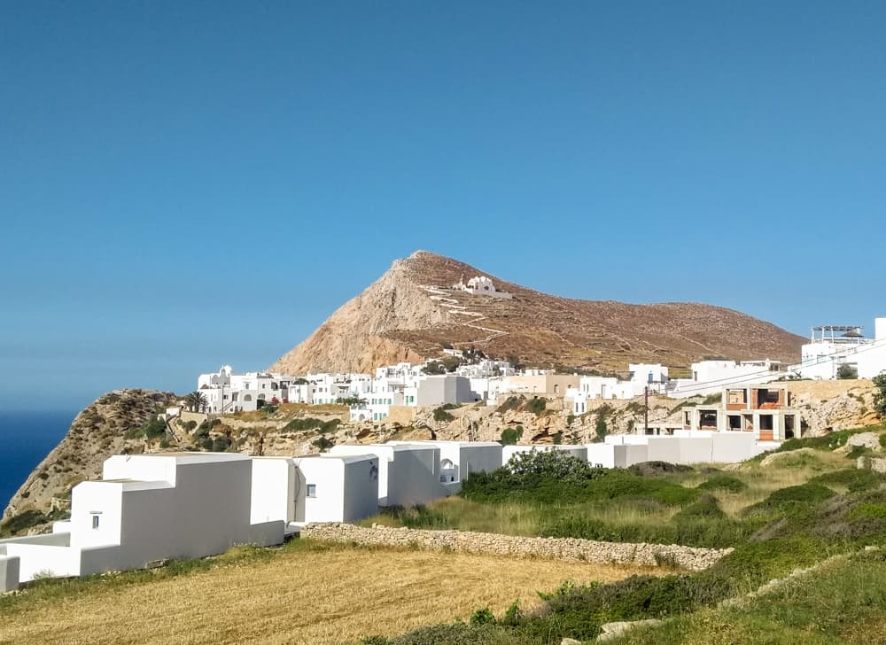 Whitewashed homes near a cliff in Folegandros, Greece.