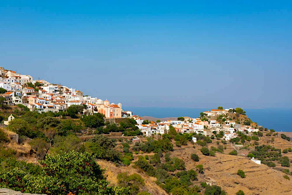 Pastel-hied homes along the coast of Kea, one of the most beautiful places in Greece.