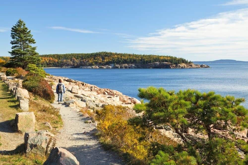 Hiker on the Ocean Path Trail in Acadia National Park, Maine.