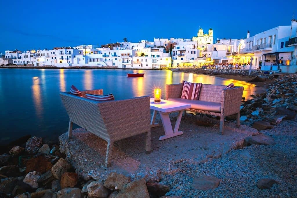 Dining in the evening by the water in Paros, one of the most beautiful places in Greece.