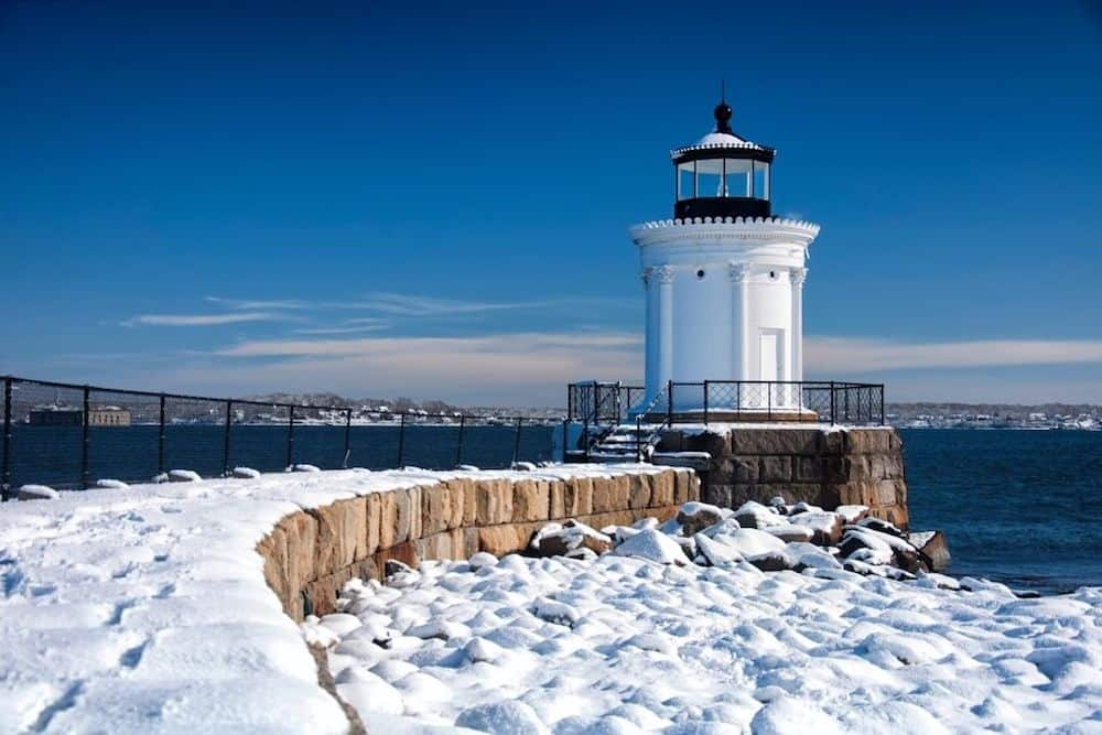 Portland Breakwater Lighthouse covered in snow.