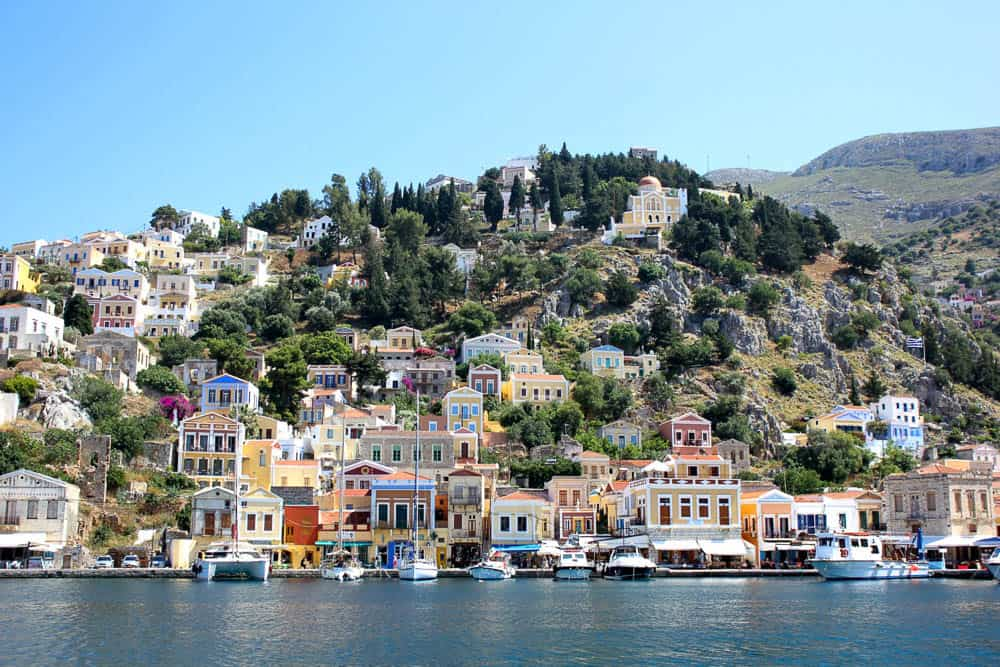 The pastel-hued homes along the coast of Symi in Greece.
