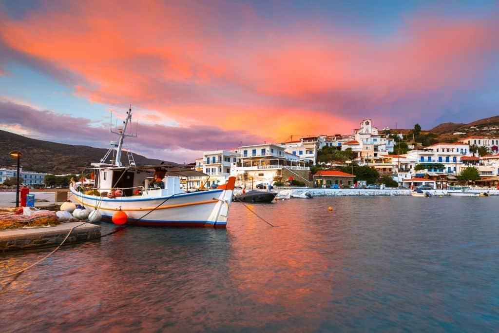 The port with boats docked near the island of Andros, Greece.