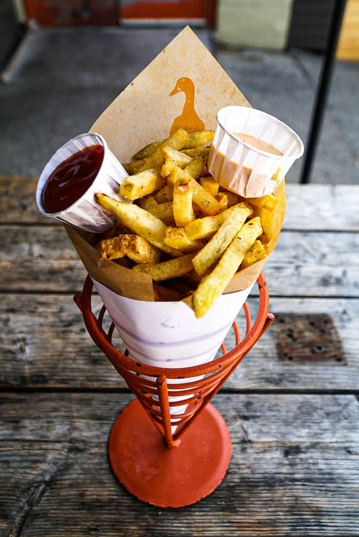 Duck fat fries with truffle ketchup and Thai chili mayo.