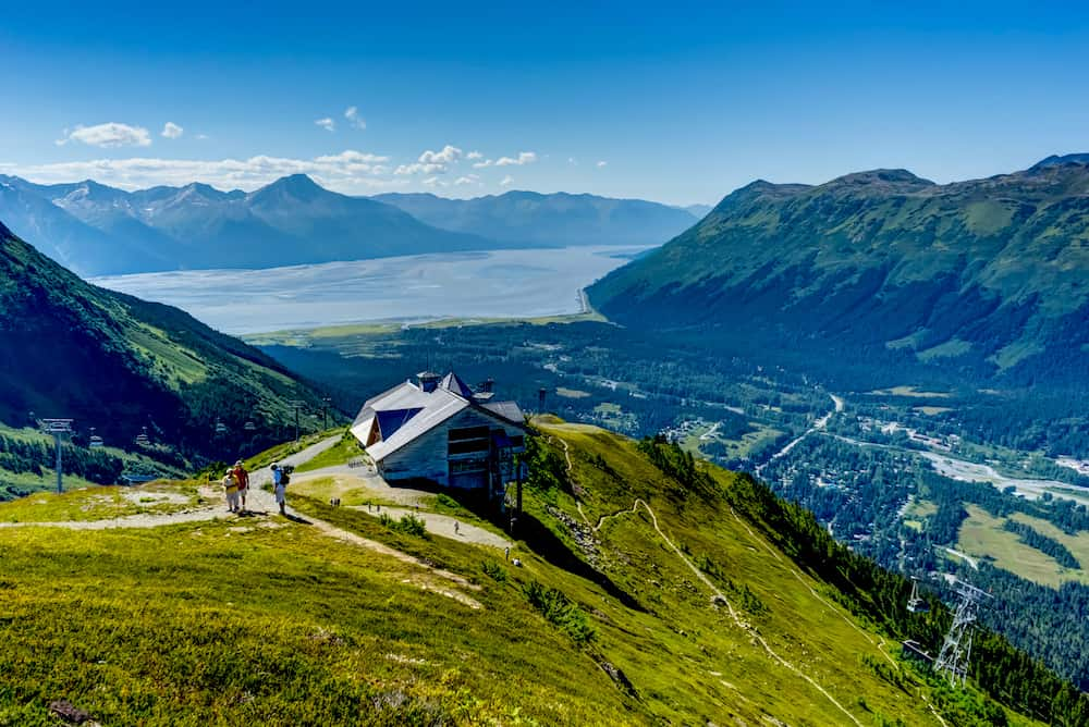 View towards and from Mount Alyeska with people and house overlook near Girdwood Alaska
