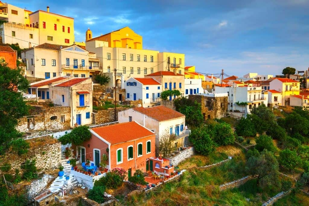 Colorful homes bathed in sunlight from the sunset on Kea island in Greece.