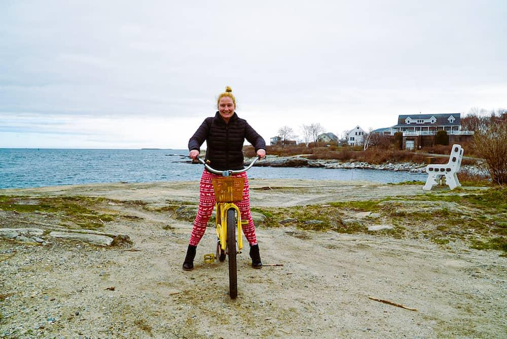 Kelly riding her bike on Peaks island
