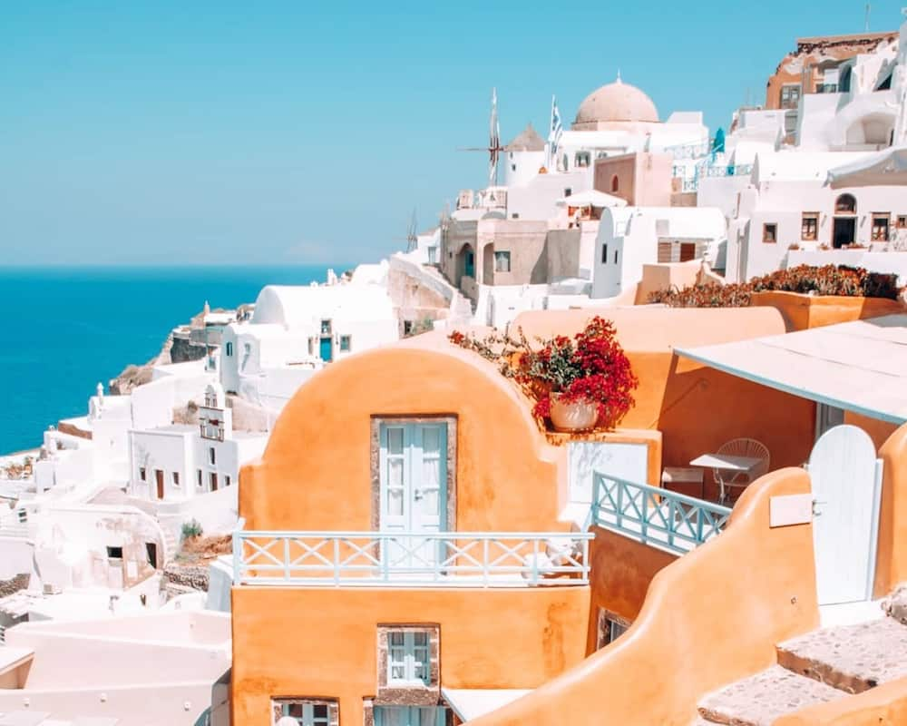 The white washed buildings and traditional windmills of Santorini.