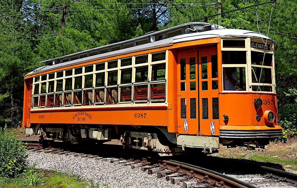 An orange, Eastern Massachusetts Street Railway car from 1918 at Seashore Trolley Museum.