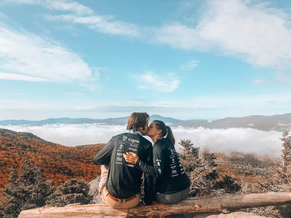Stunning views and couple kissing atop the Stowe Pinnacle in Vermont.