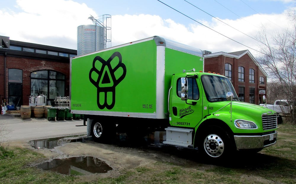 Lime green Bissell Brothers Brewing Company delivery truck.