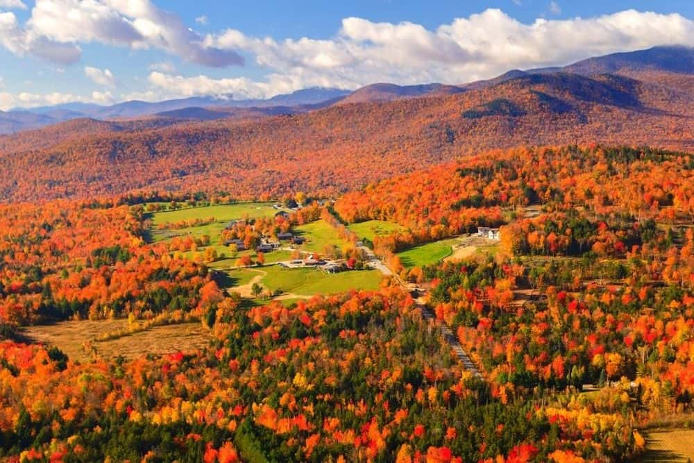 An aerial view of foliage around Stowe Vermont in the fall.