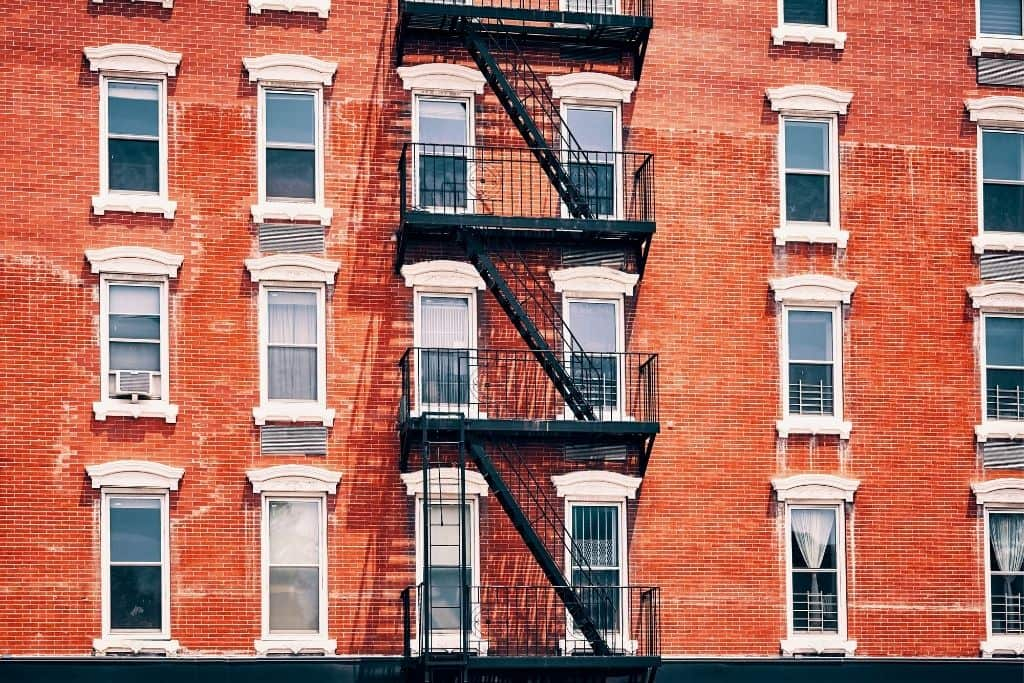 The brick facade of a historic building in NYC. Brick along happens to be one of many popular New York slang words.