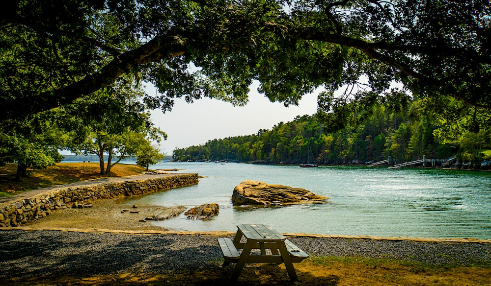 View of the water and a picnic table at Barett Park in Boothbay Harbor.