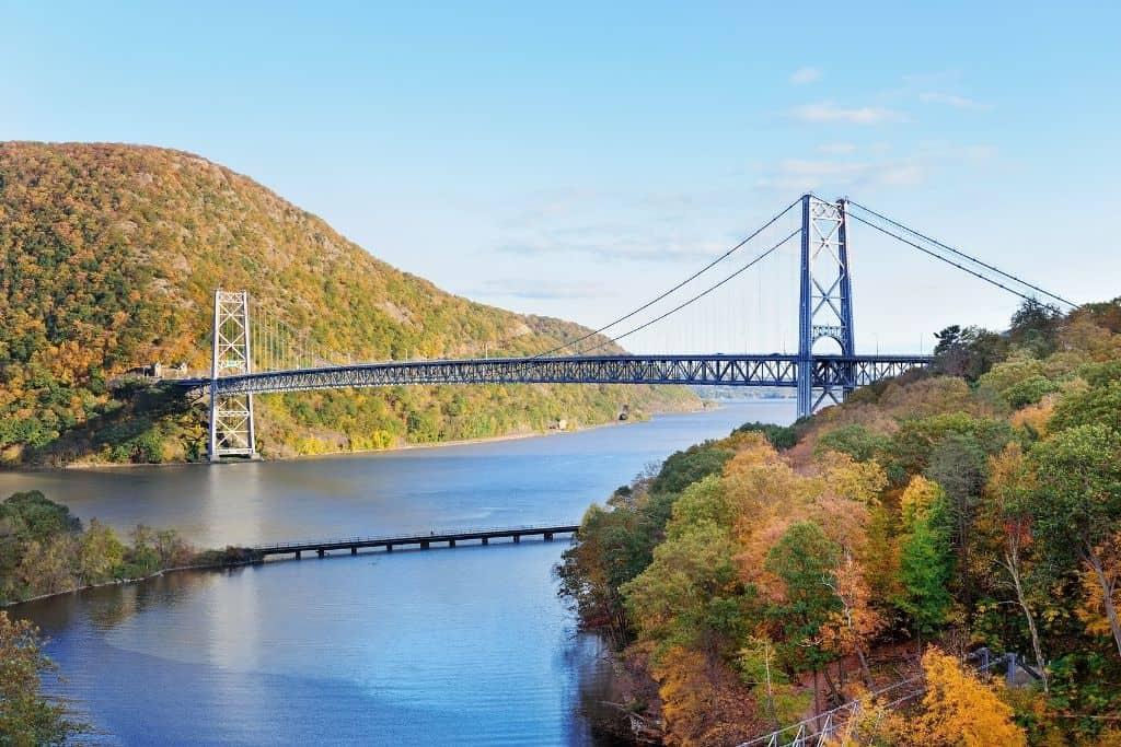 Bear Mountain Bridge across the Hudson with mountains full of foliage.