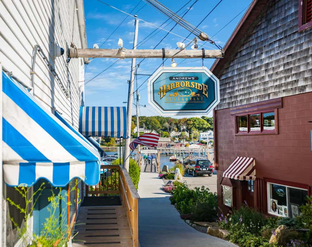 Storefronts and shop signs in Boothbay Harbor Maine.