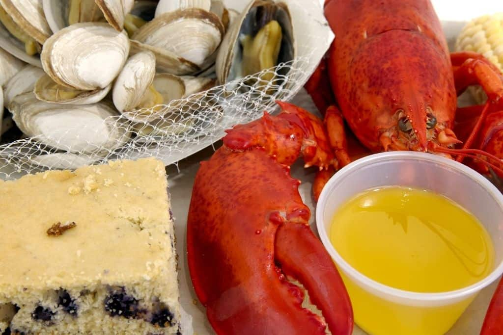 Blueberry cake, lobster, clams, and melted butter from a New England Clam Bake.