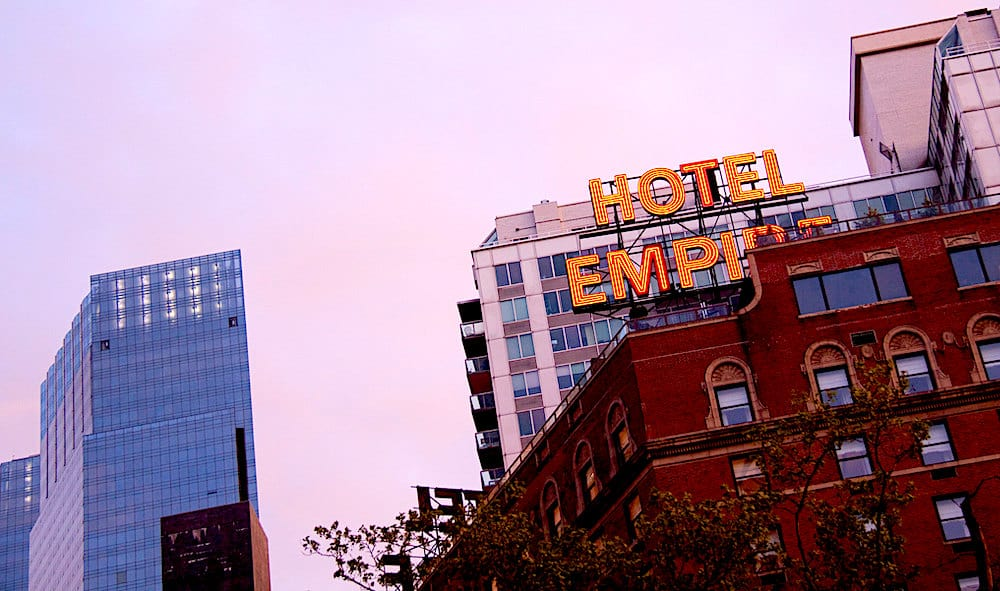 View of the sign and rooftop of the Empire Hotel in NYC.