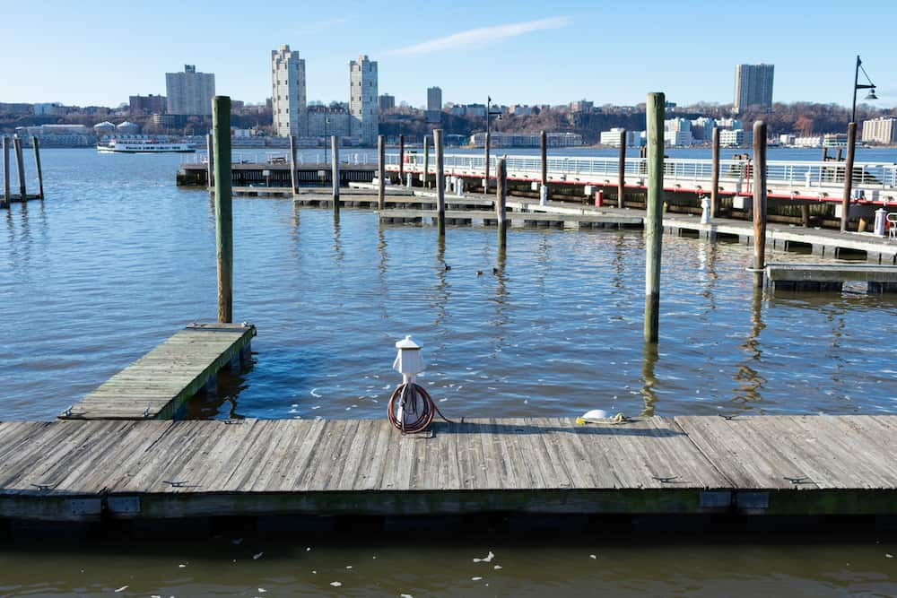 An empty wooden pier at the 79th Street Boat Basin on the Upper West Side of New York City during autumn