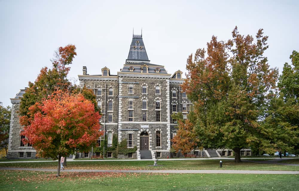 McGraw Hall surrounded by fall foliage on Cornell Campus in Ithaca Ny.