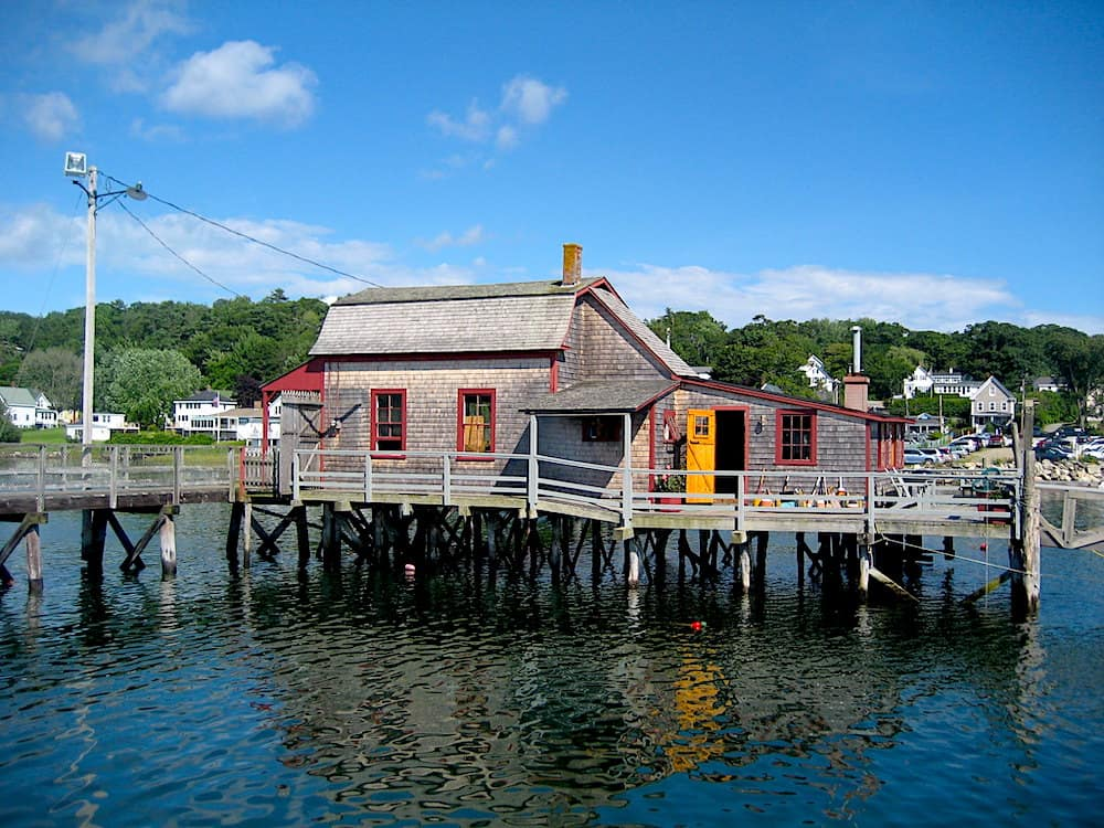 One of the best things to do in Boothbay Harbor Maine is to walk along this footbridge and since this historic house.