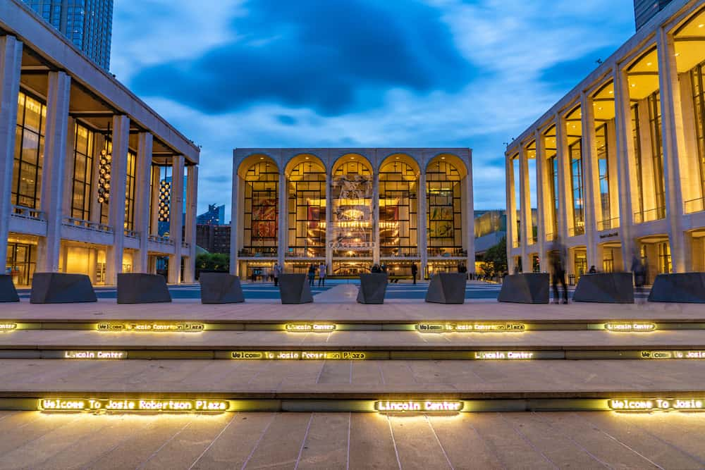 This is an evening view of the the Lincoln Center of Performing Arts in Manhattan